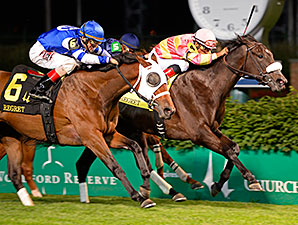 Aurelia's Belle (left) wins the 2014 Regret Stakes via DQ.
