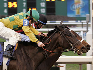 Bubbler with Eddie Martin, Jr. aboard (black cap-inside) gets a nose in front at the wire to win the Marie G. Krantz Memorial Handicap over Never Retreat with James Graham up at Fair Grounds Race Course in New Orleans, LA.