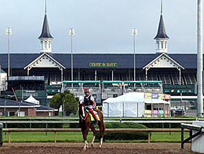 California Chrome and William Delgado in front of the twin spires of Churchill Downs.