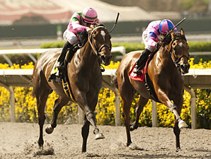 Charm the Maker, left, wins the Adoration Stakes.