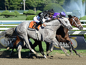 Corfu, purple silks with white blaze, wins the Saratoga Special.