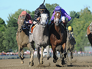 Corfu, right, wins the Saratoga Special.