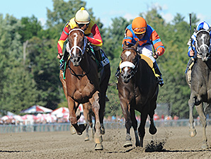 Designer Legs, orange/blue silks, wins the Adirondack Stakes.
