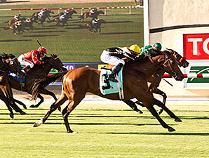 Enterprising and jockey Mike Smith, outside, nose out Argyle Cut to win the 2014 Oceanside Stakes.
