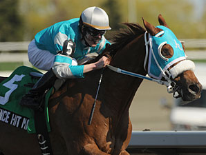 Essence Hit Man wins the 2012 Vigil Stakes.