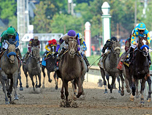 I'll Have Another leads Creative Cause, left, Bodemeister, right, and the rest of the field.