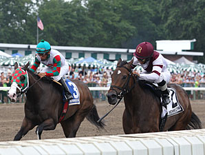 Indian Spell (right) wins the 2013 Miss Woodford Stakes.