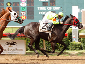 Joy's Paradise wins the 2011 Valor Farm Stakes.
