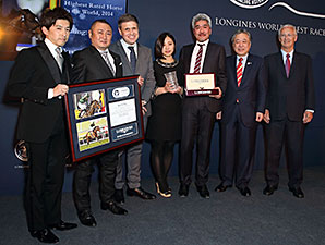 The connections of Just a Way accept the award for Longine World's Best Racehorse.