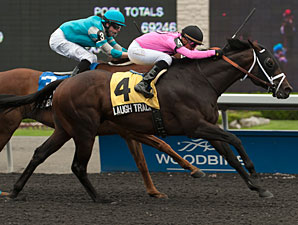 Laugh Track beats Essence Hit Man to win the Vigil Stakes.