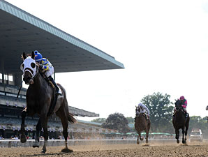 Moreno wins the 2013 Dwyer Stakes.
