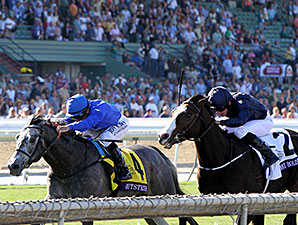 Outstrip with Mike Smith and Giovanni Boldini with Ryan Moore battle down the stretch of the 2013 Breeders' Cup Juvenile Turf.