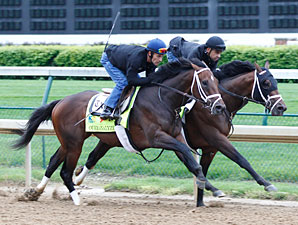 Overanalyze (outside) and Palace Malice (inside) at Churchill Downs for the Kentucky Derby.