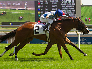 Overheard wins the Alywow Stakes.