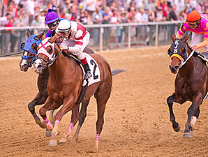 Pretension wins the 2012 Canonero II Stakes.
