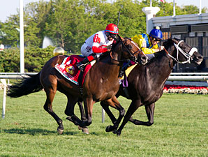 Real Solution (left) wins the Arlington Million via DQ.
