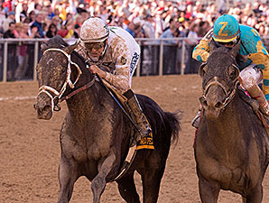 Revolutionary wins the 2014 Pimlico Special.