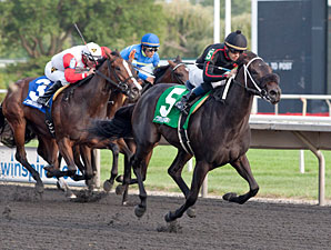She's Offlee Good wins the 2013 Arlington-Washington Lassie Stakes.