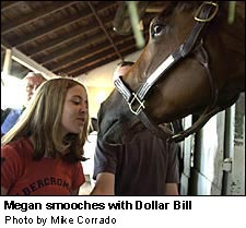Megan smooches with Dollar Bill